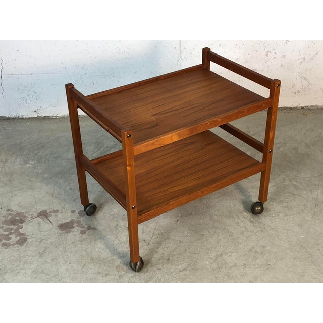 1970s Danish teak two-tier rolling cart. The cart is in newly refinished condition. It is marked underneath, Furbo Made in...