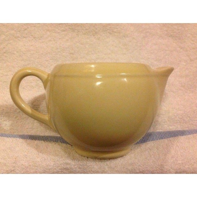 This gorgeous creamer is by Vernon Kilns. It has some serious Mid Century Modern style going on with is clean lines and...