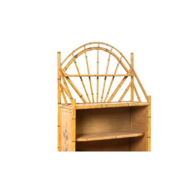 A 19th century english bamboo bookshelf with lovely painted finish.