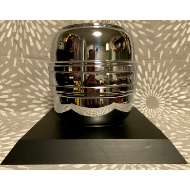 This large trophy consists of a silvered metal beer keg on a black wood base. The metal plaque is engraved with the...