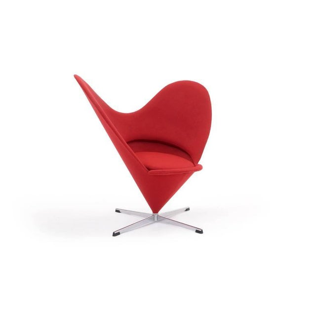 One would be hard pressed to find a finer original example of this design. This Verner Panton heart chair, in classic red,...