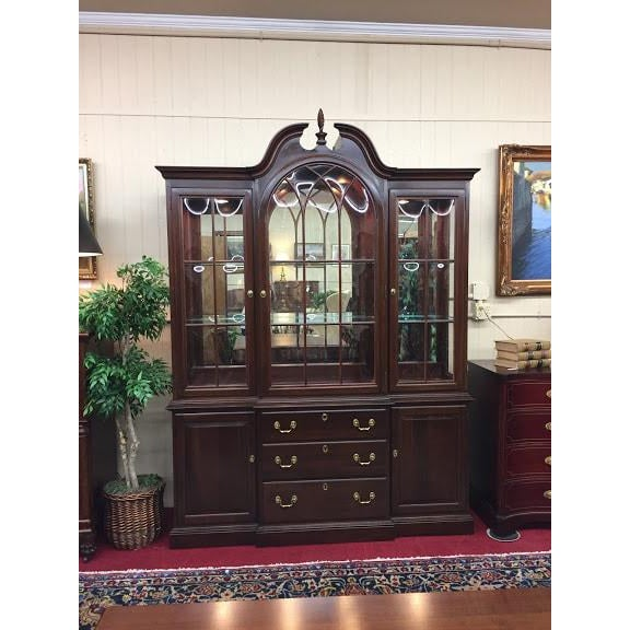 Ethan Allen Lighted Breakfront in solid cherry. This beautiful china cabinet has so much style and storage! The lighted...