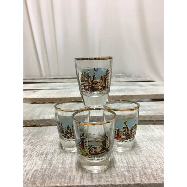 A set of four vintage mid-century era shot glasses featuring famous destinations in London (Piccadilly Circus, Tower...