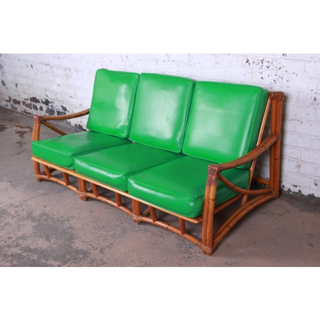 Offering a nice and unique Mid-Century Modern Regency style sofa attributed to Heywood-Wakefield. The sofa has the...