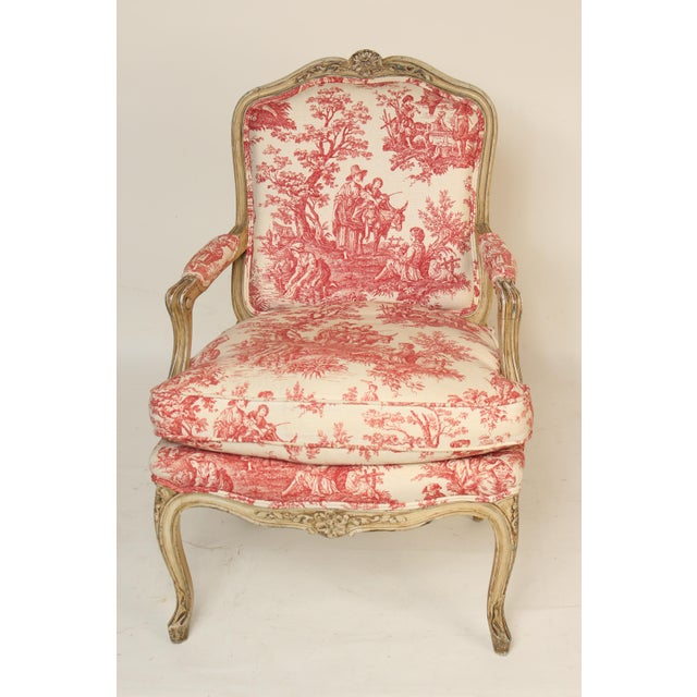 Louis XV provincial style painted armchair with red toile upholstery, circa 1930's. The seat cushion is 50% down and 50%...