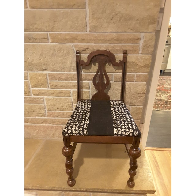 Sweet small scale traditional vintage wood chair with authentic African mudcloth upholstery. Solid wood chair in excellent...