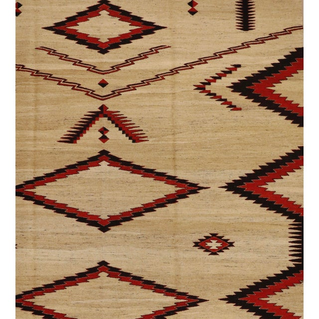 This is a vintage navajo- inspired handmade flat-woven rug from the 90s. The piece is woven using a sturdy textile that's...