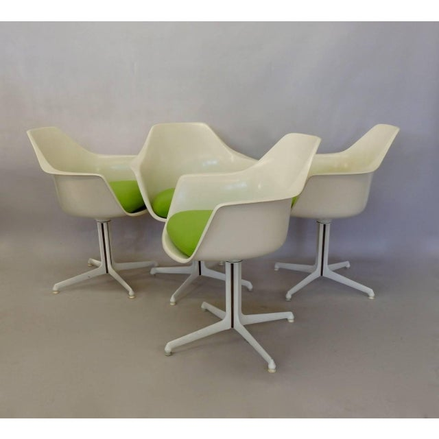 Four Burke dining arm chairs. Very nice original finish new cushions covered in Maharam Kvadrat textile.