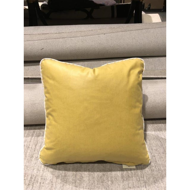 The TP2020 Throw Pillow is a first quality showroom sample that features a yellow fabric with a fiberdown fill.