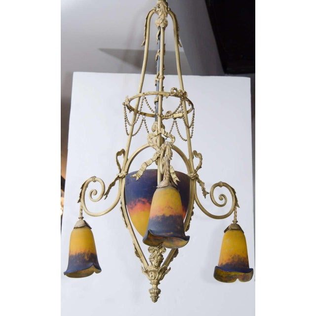This unique Art Deco chandelier by was realized circa 1925 by Muller Freres, one of the most esteemed French glass studios...