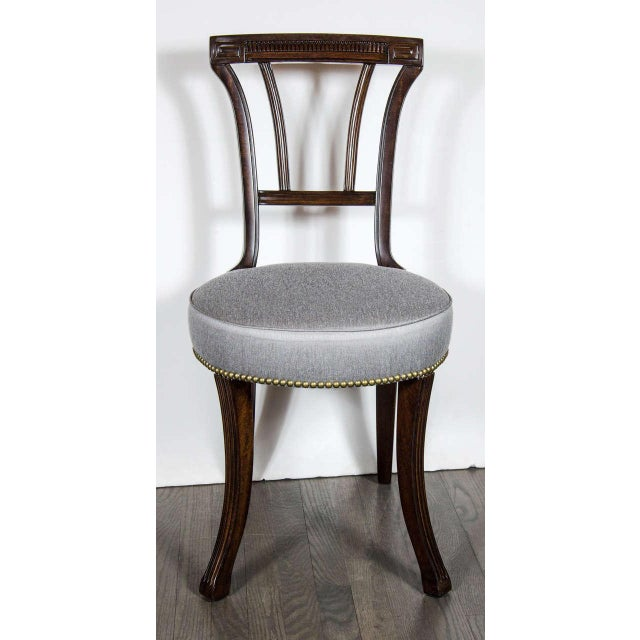 This pair of sophisticated 1940s Hollywood occasional chairs by Grosfeld House features a rounded seat in new silver...