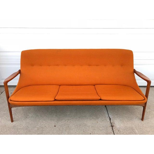 6659fe6757e4 Mid-century modern stylish vintage high-back sofa with teak armrests  combines Scandinavian Modern. Danish Modern 1960s ...