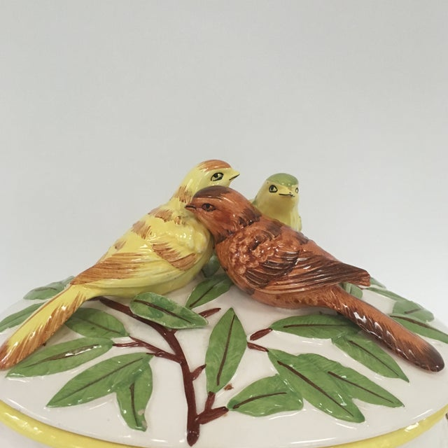 Ceramic bird soup tureen with badketweave design has ladle slot and underplate. Top has birds and leaves. Beautiful piece...