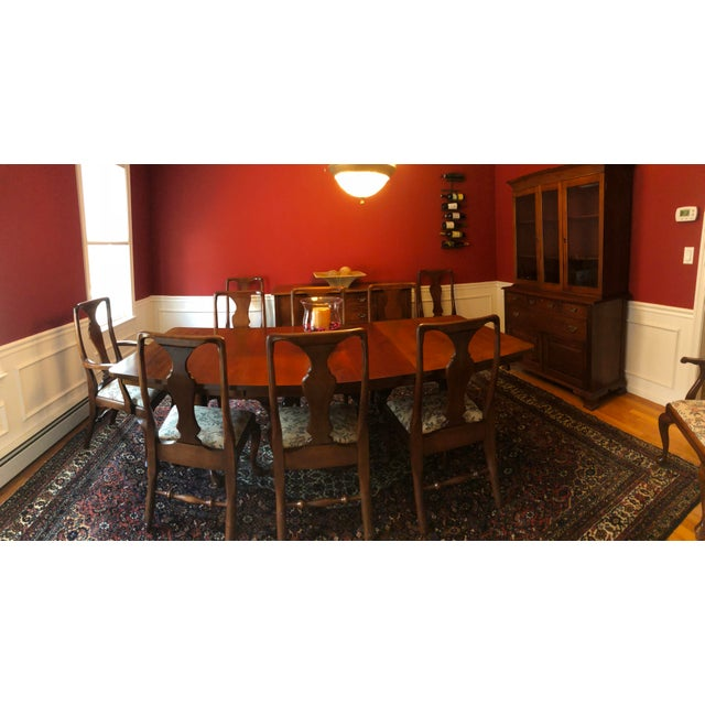Solid mahogany Queen Anne style dining room table and 10 chairs made by Craftique, who specialized in heirloom quality...