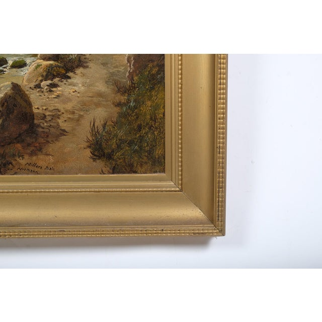 "A Representational Landscape featuring a Rocky River Scene. Oil on canvas by Edmund John Niemann. Labeled on verso ""E. J...."