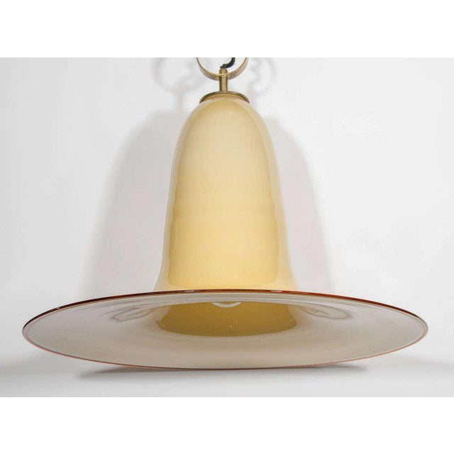 Mid-Century Modern large pendant chandelier with stunning elongated bell formation. Handblown Murano glass in hues of...