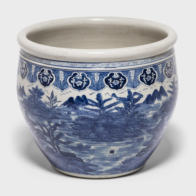 This grand, blue-and-white porcelain bowl is hand-painted with a traditional shan shui pattern, a form of Chinese...