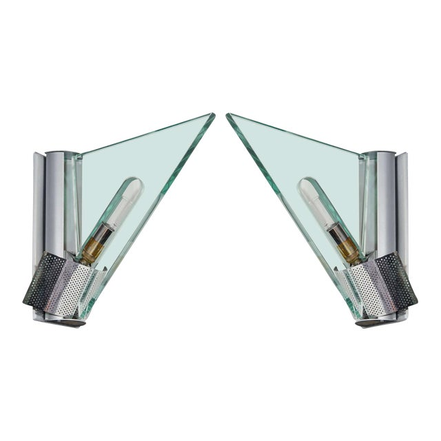 Pair of Mid Century architectural sconces featuring triangular glass shades with and cut-out centers. Light sockets fitted...
