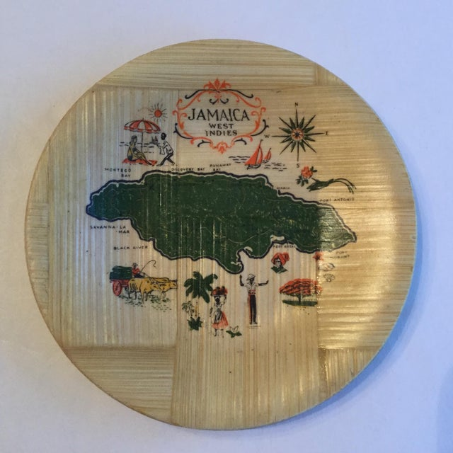 Four bamboo coasters from Jamaica. A map of Jamaica is painted on each one surrounded by tourist points of interest.