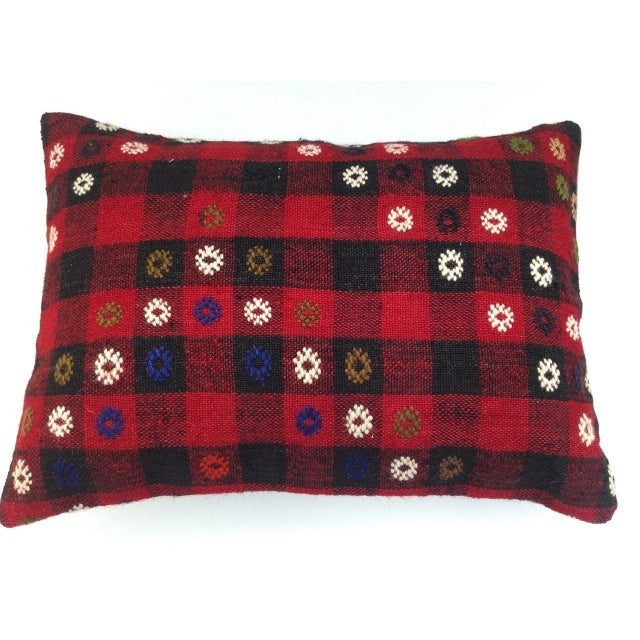 A vibrant Kilim pillow case made from the highest quality antique 100% wool Kilim on the front and cotton on the back. Put...
