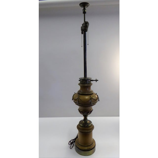 Spectacular Hollywood Regency very tall table lamp in pecan wood finish with bands of reddish brown accented in brass...