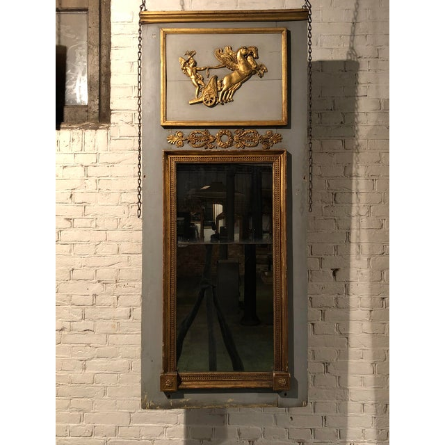 Louis XVI , Trumeau , gilt wood with its original mercury mirror glass. This mirror is adorned with floral and foliate...