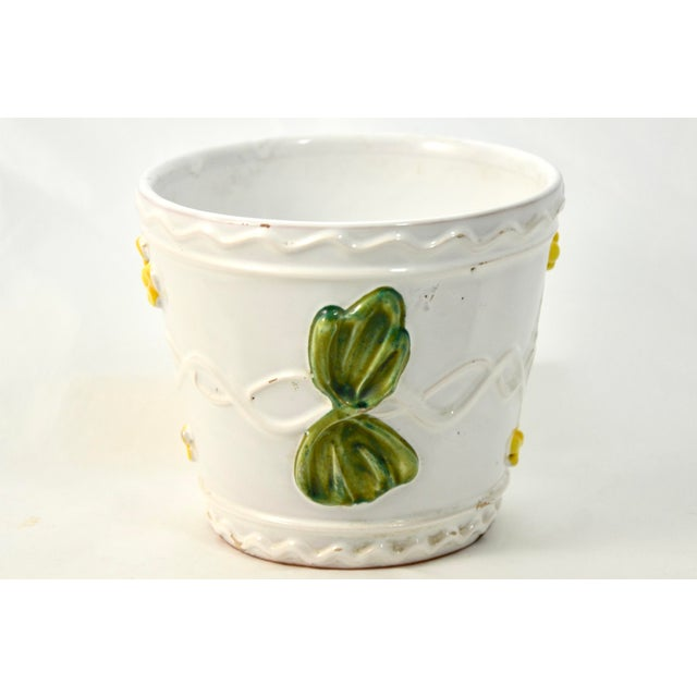 Vintage Italian terra cotta planter with bright green and yellow Capodimonte-style raised floral design on bright white....