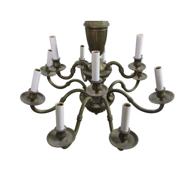 This is a brass hanging eleven candle chandelier. This piece is all newly rewired for immediate installation. The candle...