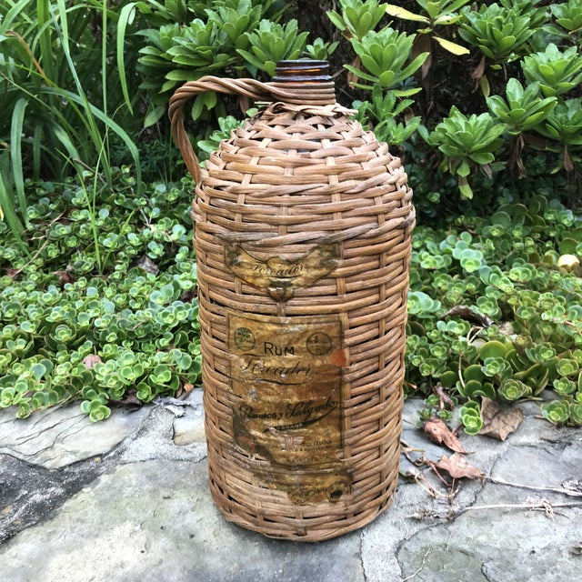 Vintage wrapped demijohn rum jug. Made in the 1920s in the style of boho chic.
