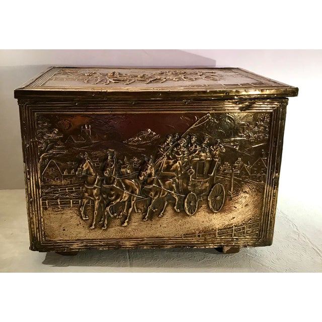Beautiful brass plated wooden box for holding kindling. Love the Embossed design of the carriage and horses! Lions head...