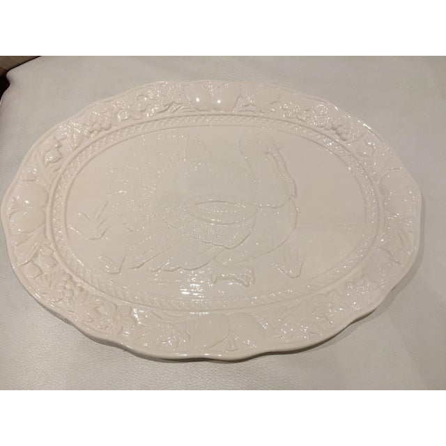 Vintage chic and classy oblong ceramic white Thanksgiving turkey platter made in Japan is embossed with a raised turkey...
