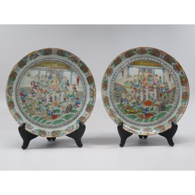 A pair of antique plates made in China around 1800. Hand decorated in the very popular and exotic - Famille Rose pattern,...