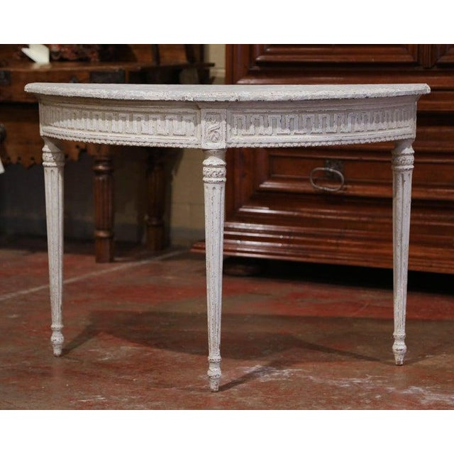 Decorate an entryway with this sophisticated pair of antique painted consoles. Crafted in northern France, circa 1880 and...