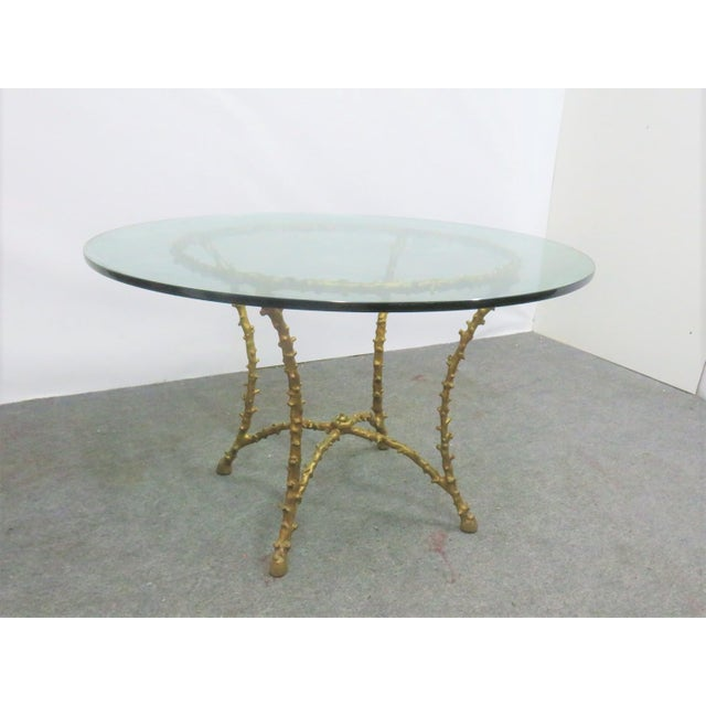Maison Bagues style Table. Could function as a center table or a dining table . It has a gilt iron tree branch form base...