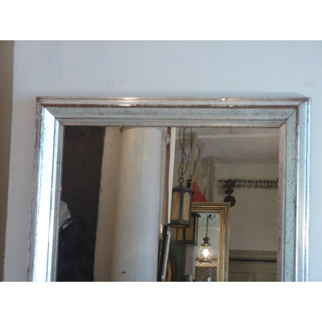 Antique silverleafed frame with clouded, distressed mirror, the silver on the mirror, antiqued with speckling and dark...