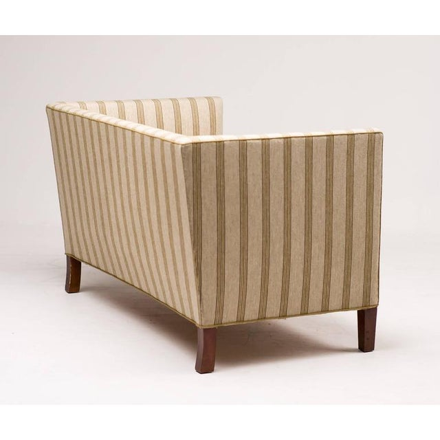 Danish modern sofa, manufactured by Fritz Hansen. Classic superior construction with a beech frame, coil springs and...