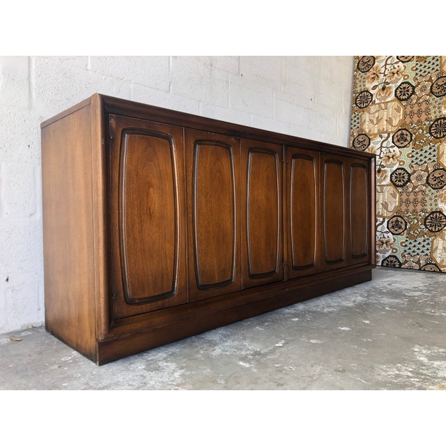Vintage Mid Century Modern 1960s Sideboard Credenza from the Emphasis Collection by Broyhill Premier Funiture. Features an...