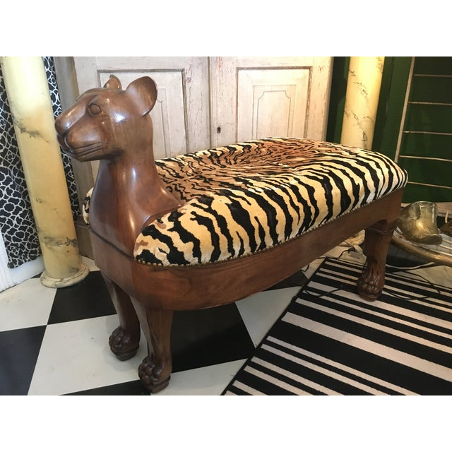 One of a kind, wooden tiger bench from 1950's. This hand carved bench is in excellent condition with luxurious soft fabric.