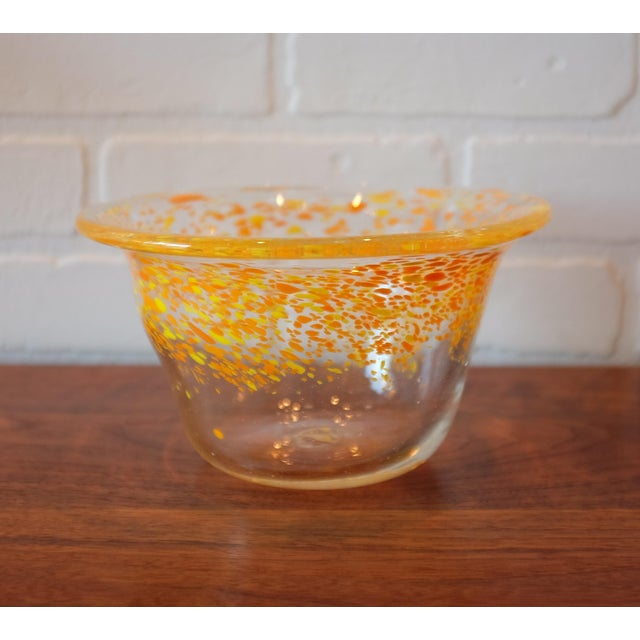 This sunny bowl will take the gray out of your day! Citrus toned hand blown glass decorative bowl with orange and yellow...