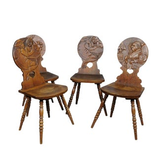 A Set Of Four Carved Whimsy Black Forest Board Chairs Ca. 1900 For Sale