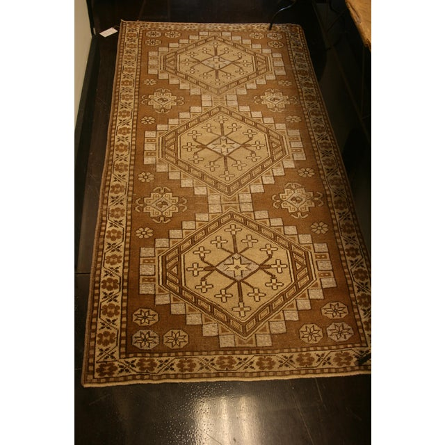 Runner sized rug with geometric pattern.