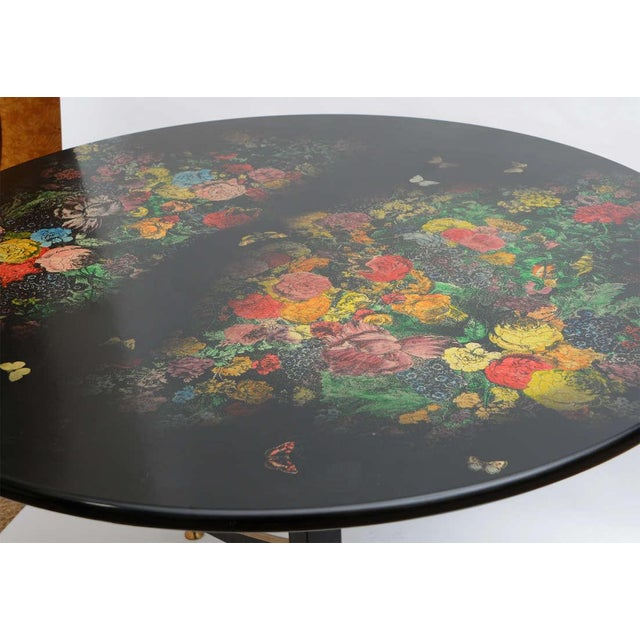 Wonderful table from the 1950s with flowers on the top. Four tapered legs with brass detail leading up to a vertical...