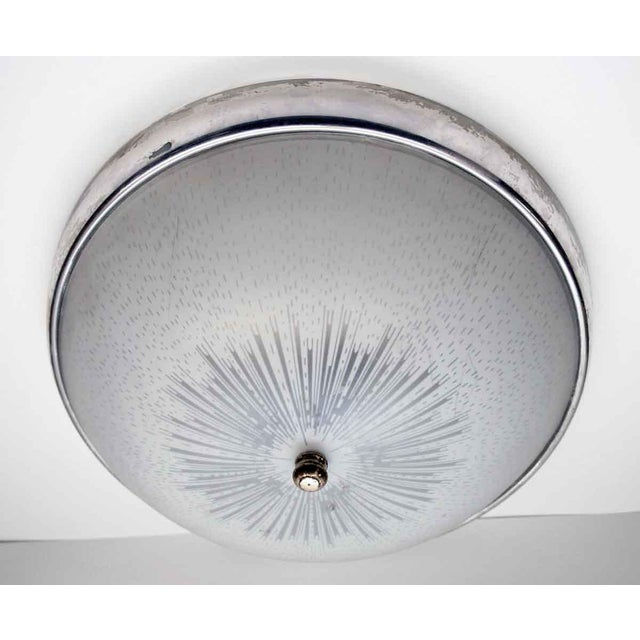 A classic flush mount fixture from the 1950s. The nickel around the trim is in good condition with a nice warm patina....
