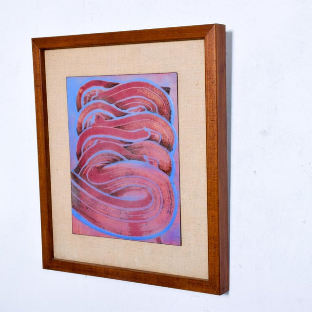 We are pleased to offer for your consideration, a Mid Century Modern Abstract Enamel Art. Not signed. Framed with teak...