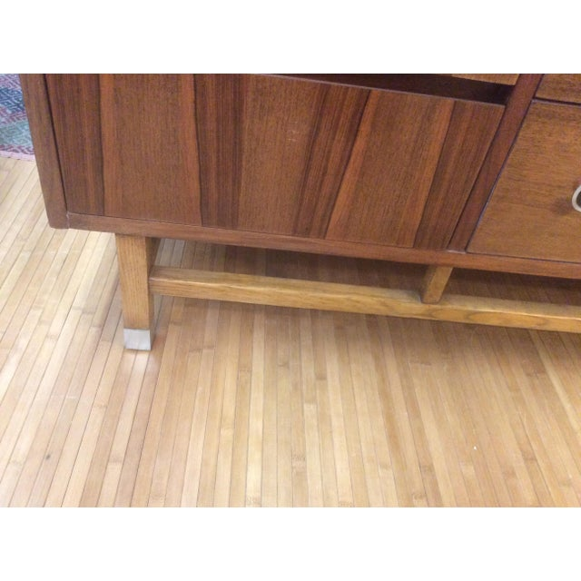Rare Vintage Mid Century Credenza on a square legs with chrome capped feet, sculpted chrome handle. In walnut with...