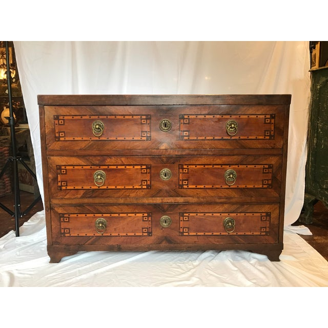 French Louis XVI 3-drawer inlaid commode with circular bronze pulls and escutcheons. All three drawers pull easily and are...