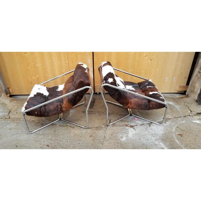 Vintage Mid Century Modern Italian Chrome Tubular Framed Scoop Sling Chairs Newly Upholstered In Brazilian Cow Hide - Pair...