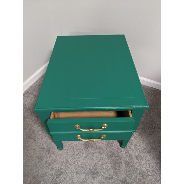 Beautiful bold hand painted Emerald green side table with gold accent knobs. Mid Century straight legs. Great for living...
