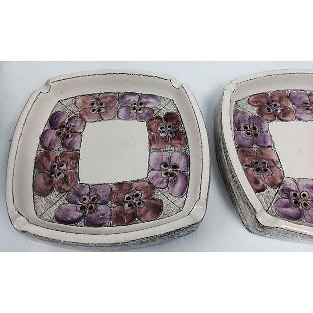 Pair of handmade and decorated with delicate lilac tones flowers ceramic ashtrays. Some wear.