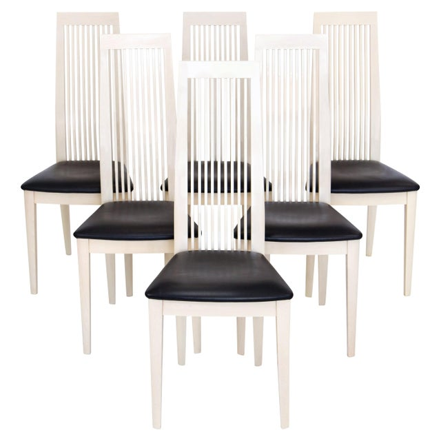 Set of six post-modern Italian high back dining side chairs by Potocco with ash wood frames and black leather seats. The...